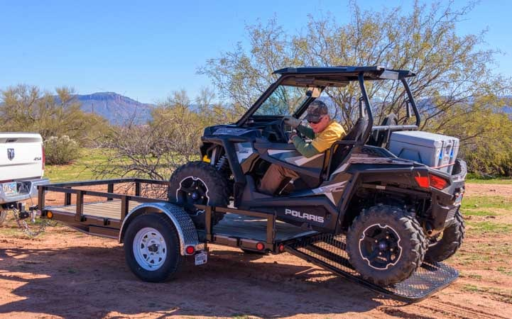 Unloading Polaris RZR 900 XC EPS edition off of trailer-min
