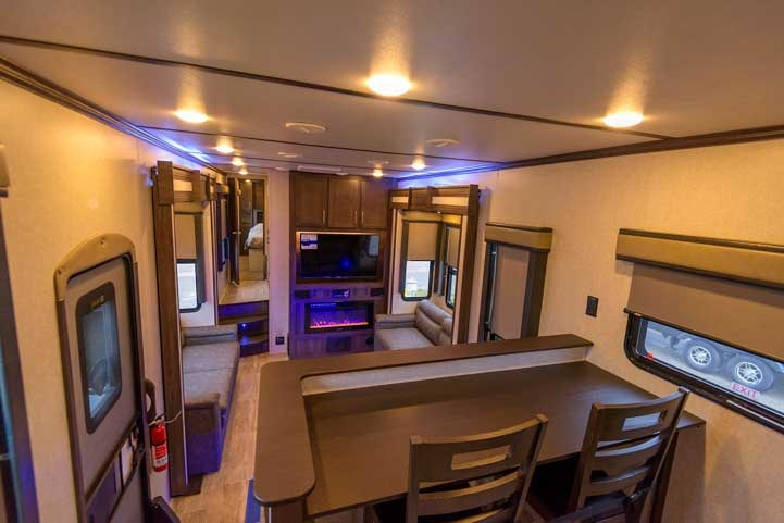 Keystone Raptor 427 toy hauler fifth wheel view into Living Room from Kitchen-min