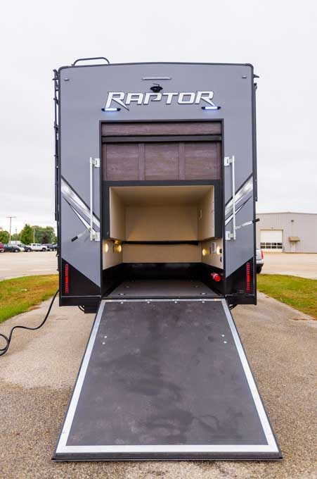 Keystone Raptor 427 toy hauler fifth wheel ramp door-min