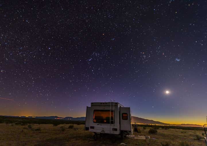 RV fifth wheel trailer under the stars-min