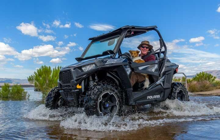 Polaris RZR driving through water in Arizona-min