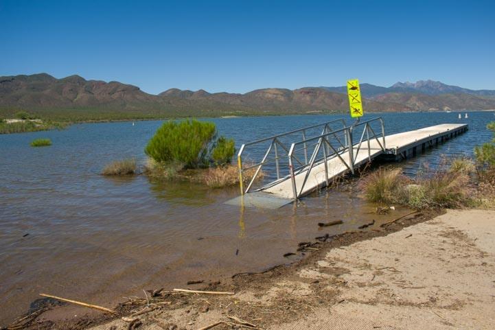 Submerged dock and boat ramp at Roosevelt Lake-min