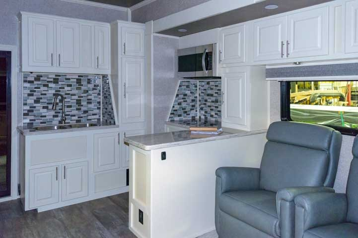 Luxe fifth wheel toy hauler RV White interior-min (1)