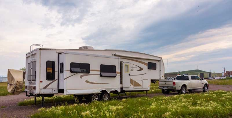 Pull-through campsite at Americas Mailbox RV Park Box Elder South Dakota-min