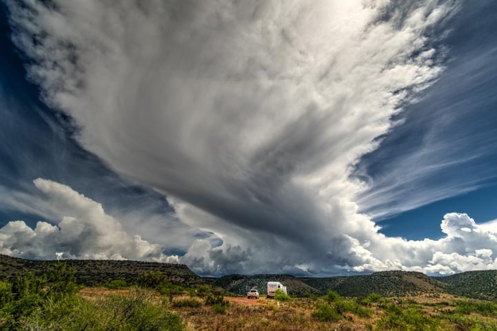 Fifth wheel RV under storm clouds in Arizona-min