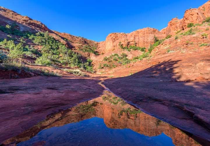 Reflected Red Rocks in Sedona Arizona on Hog Heaven hike-min
