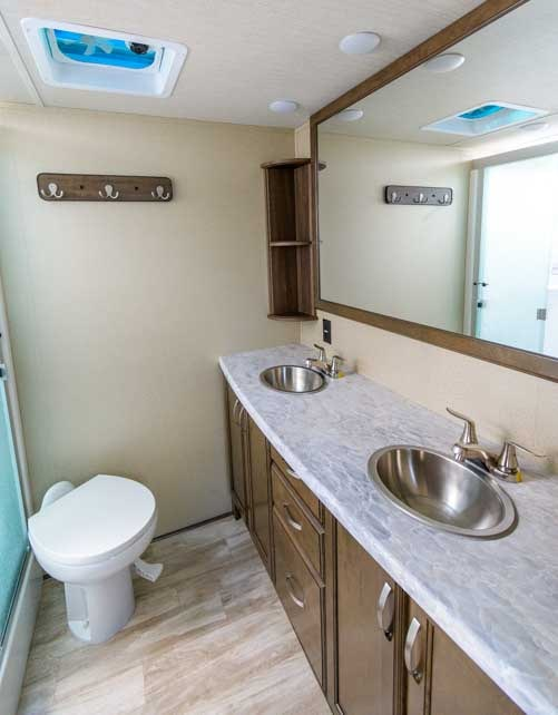 Double vanity sink in bathroom of fifth wheel trailer RV-min