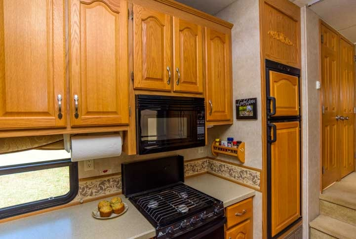 Fifth wheel RV kitchen with 8 cubic foot RV refrigerator
