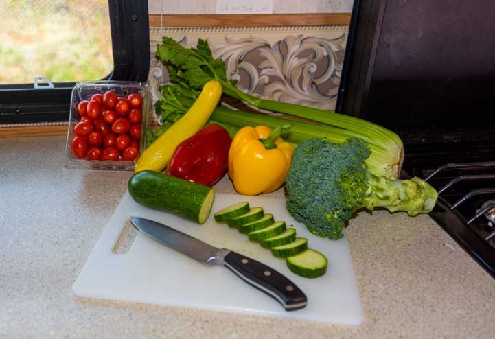 Fresh veegetables ready to be cut and stored in an RV refrigerator-min