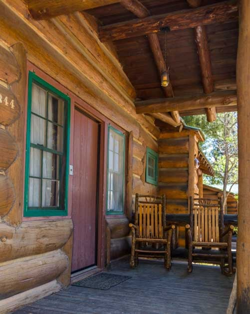 Log rocking chairs on the porch of a cabin at Grand Canyon North Rim-min
