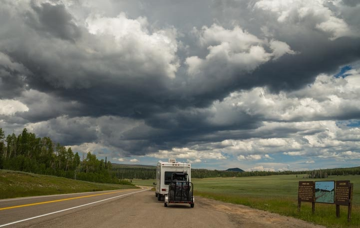 Storm clouds over fifth wheel trailer-min