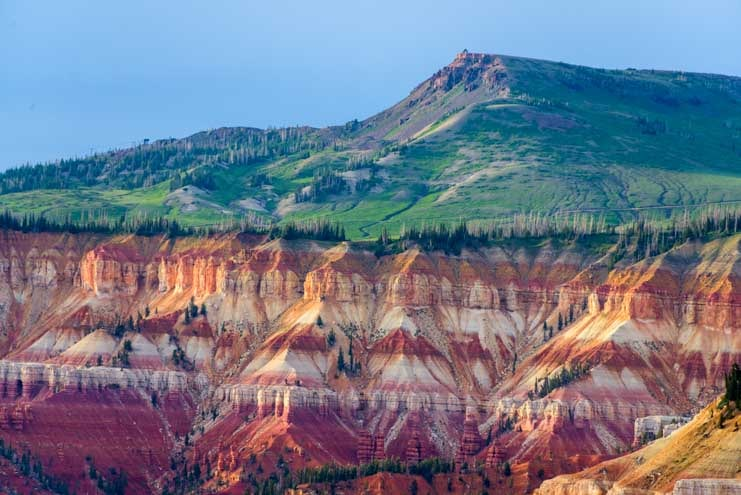 Green mountain and red rocks at Cedar Breaks National Monument Utah-min
