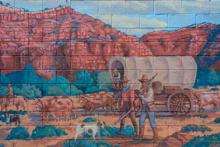 Mural in Kanab Utah weary wagon train travelers-min