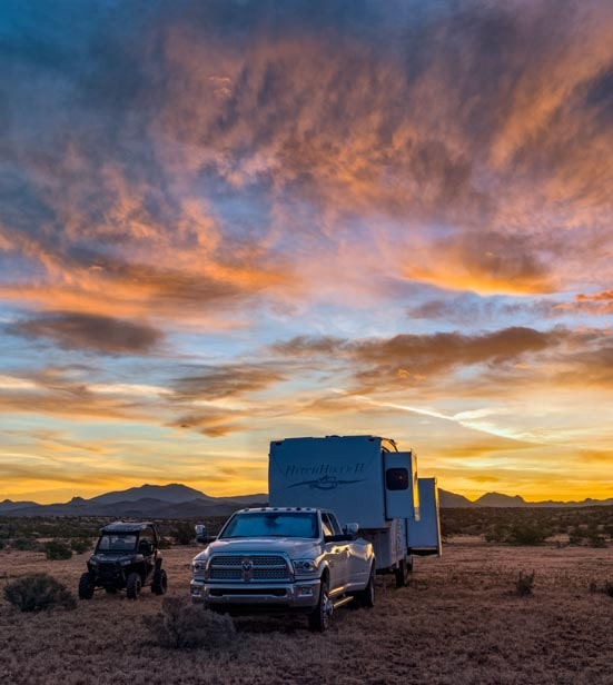Fifth wheel RV camping at sunset-min