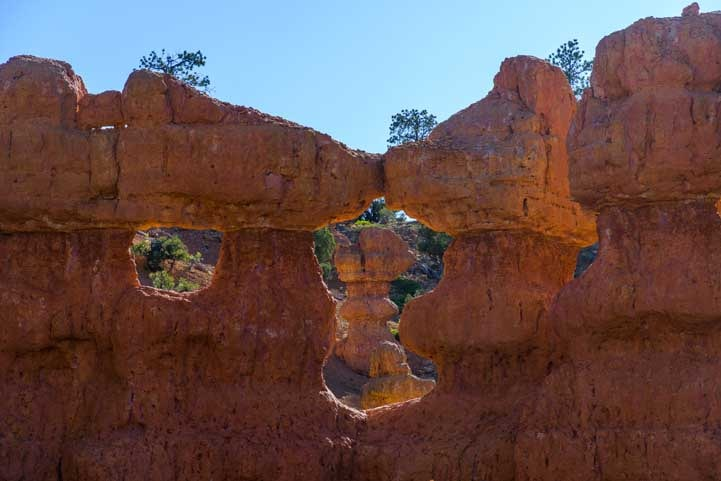 Pinnacle in an arch on Arches Trail Red Canyon Utah-min