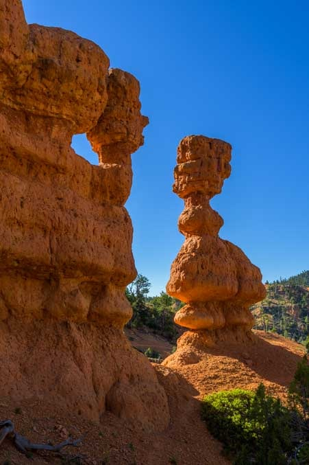 Chess piece pinnacle on Arches Trail Red Canyon Utah-min