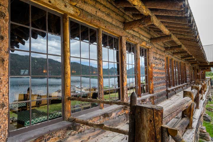 FIsh Lake reflects in the dining room windows at Fish Lake Lodge Utah-min