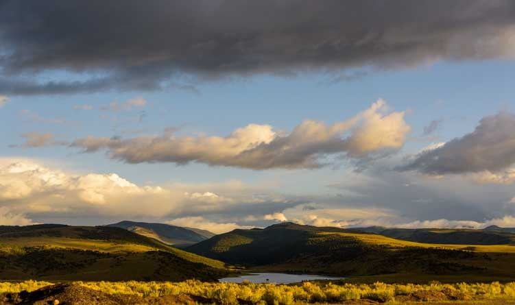 Light and shadow with storm clouds Forsyth Reservoir Utah-min