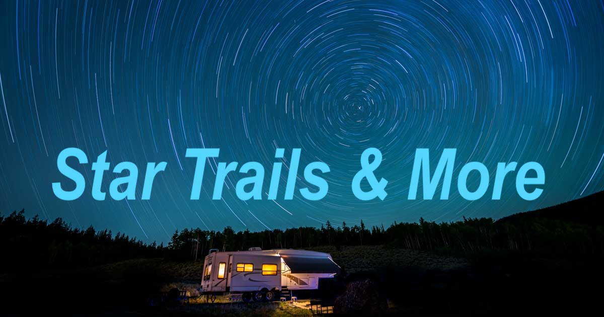 Star trails over RV in clear night sky