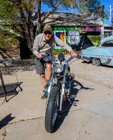 Posing with James Dean motorcycle Seligman Arizona on Route 66-min