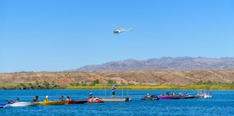 Helicopter surveys the starting line of Arizona Drag Boat Association Race at Blue Water Casino-min