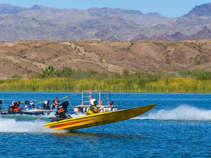 Popping a wheelie at the start line of Arizona Drag Boat Association Race in Parker AZ-min