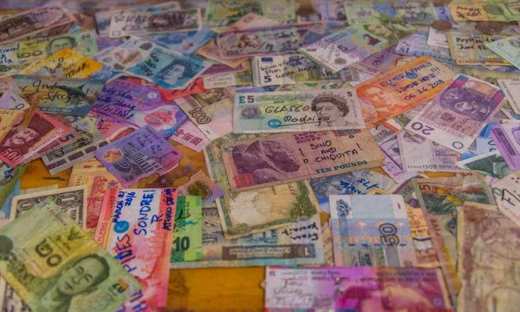 International currencies at gift shop Seligman Arizona on Route 66-min