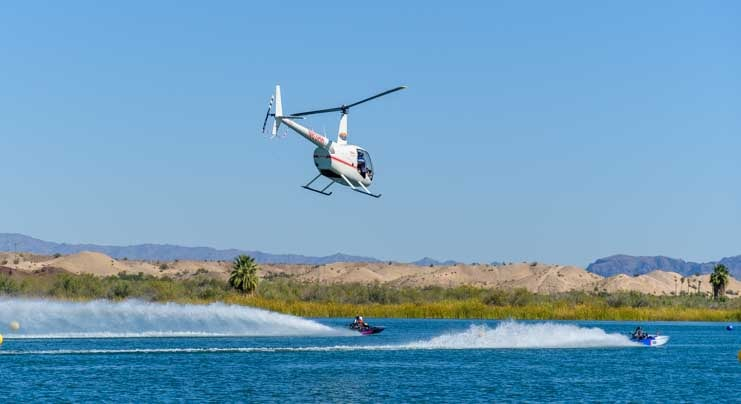 Helicopter chases two drag boats at the ADBA drag races on Lake Havasu-min