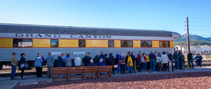 Tourists line up to take the train at Grand Canyon Railway in Williams Arizona-min