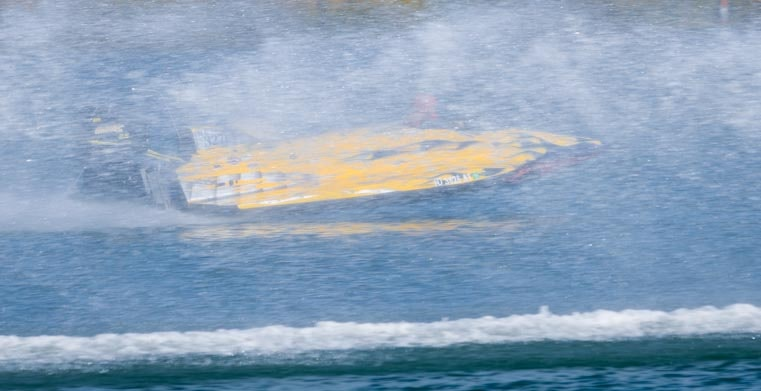 Through the spray in a drag boat race-min