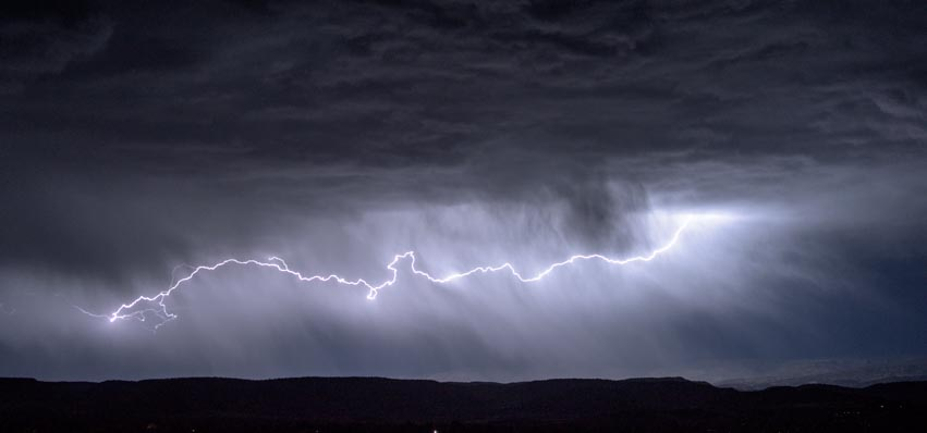 Lightning bolt across the sky horizontally