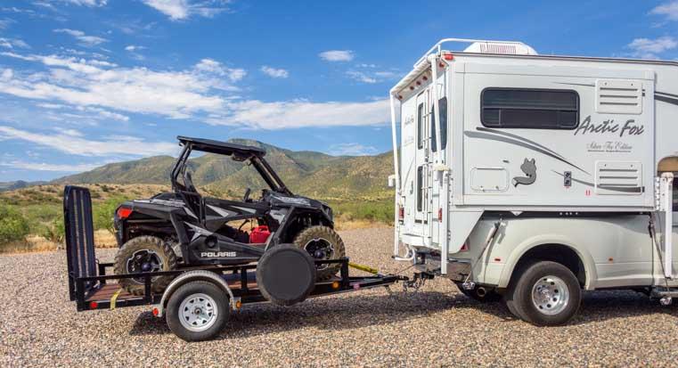 2005 Arctic Fox 860 Truck Camper towing Polaris RZR 900 XC