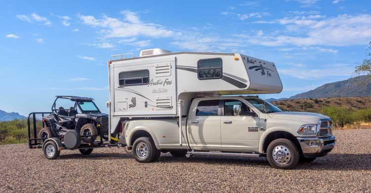 Arctic Fox 860 Truck Camper towing Polaris 900 RZR