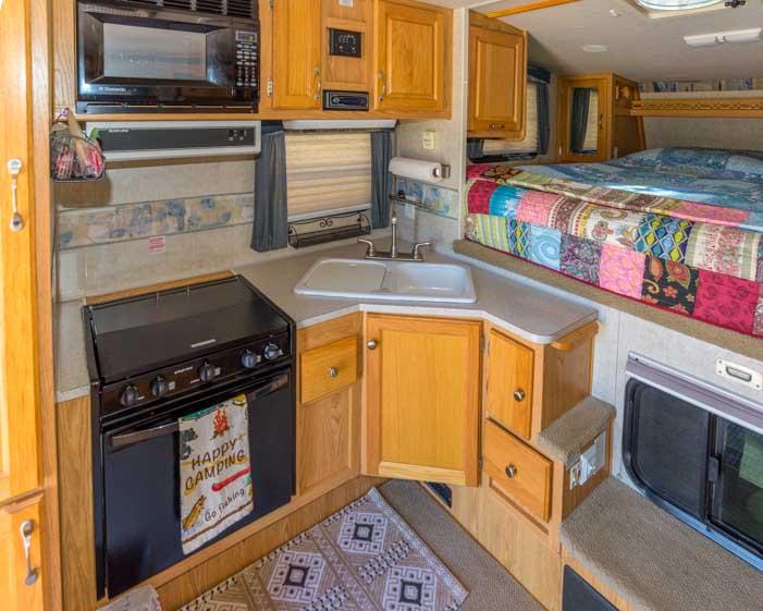 Arctic Fox 860 truck camper kitchen
