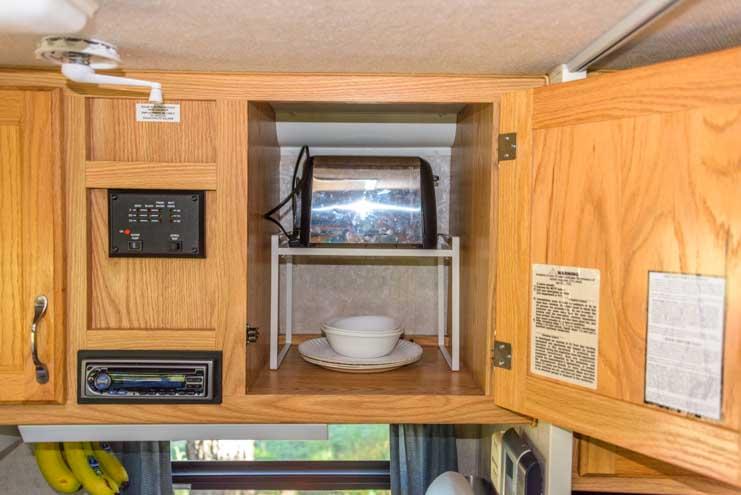 Standalone shelf for kitchen cabinet in truck camper