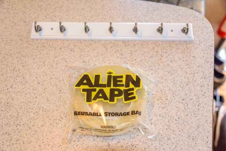 Key hooks and Alien Tape for mountain inside RV camper