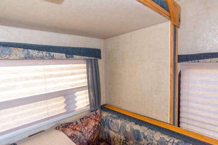 Empty wall inside RV truck camper dinette