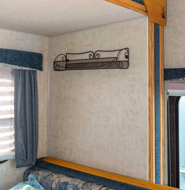 Spice rack doubles as a shelf for extra storage in a truck camper