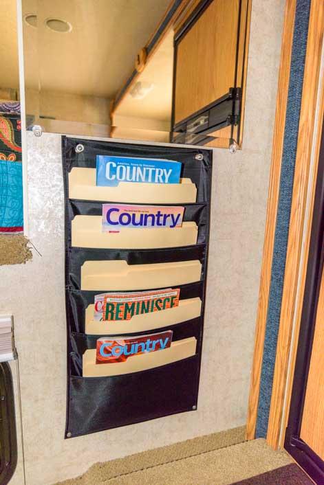 Hanging wall magazine storage in RV truck camper