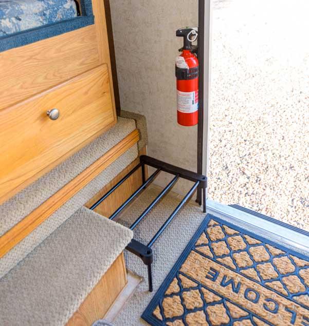 Shoe rack inside RV truck camper doorway
