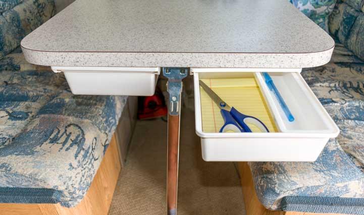 Under desk drawer storage in a truck camper