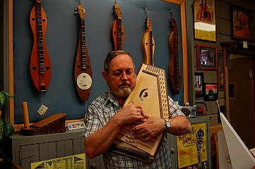 Playing autoharp at The Dulcimer Shoppe, Mountain View, AR