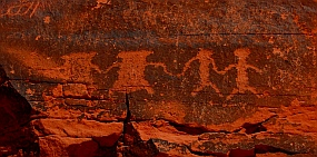 Petroglyph rock art, people holding hands