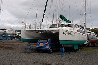 Seawind Catamaran with a car parked under it.