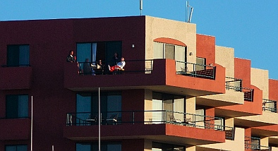 Crew of It's OK looks out over Hotel Coral & Marina