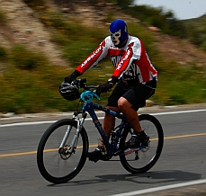 Cyclist in a wrestling mask