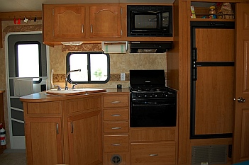 The kitchen in our 27' Fleetwood Prowler Lynx 270FQS travel trailer was a little small for our fulltime RV lifestyle
