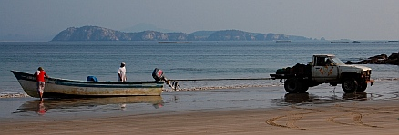 Towing a panga up on the beach at Bahia de Chamela