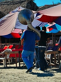 Tuba player on La Boquita Beach, Santiago Bay, Manzanillo, Colima, Mexico