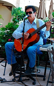 Musician plays guitar in Loreto, Baja California Sur, Sea of Cortez, Mexico